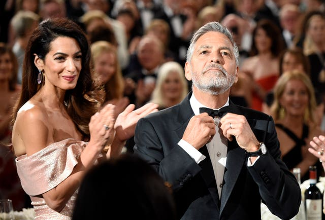 George Clooney adjusts his bow tie at the 46th AFI Life Achievement Award (Chris Pizzello/Invision/AP)
