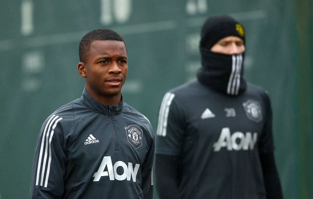 Ethan Laird, left, pictured at United training