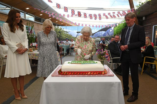 The Queen cutting a cake