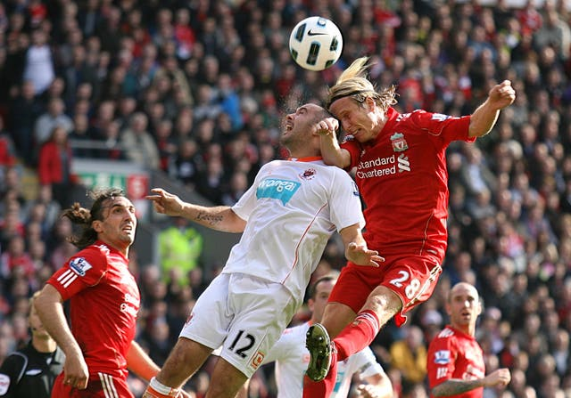 Christian Poulsen, right, made 12 appearances for Liverpool during the 2010/11 season