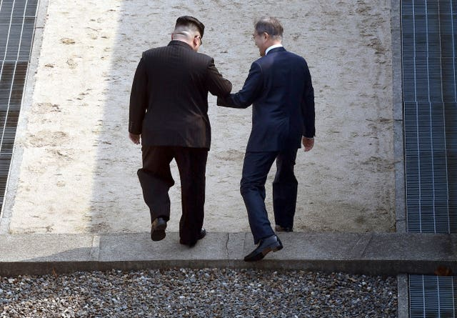 After the handshake the two men stepped back into North Korea (Korea Summit Press Pool via AP)