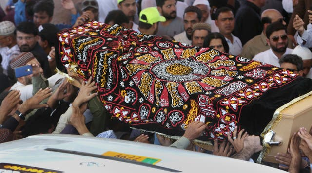 Mourners carry the casket of Syed Areeb Ahmed, a victim of the Christchurch mosque shootings, during his funeral in Karachi, Pakistan