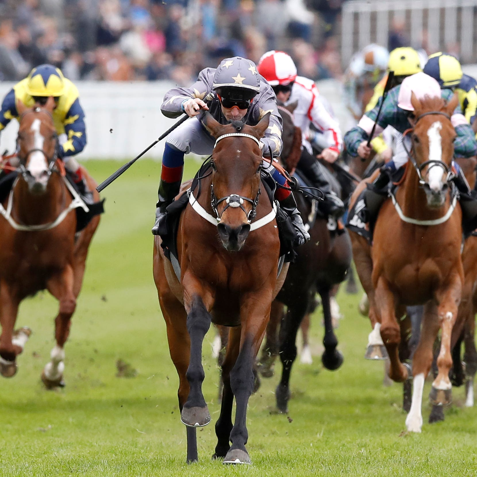 Magic Circle (centre) winning the Chester Cup in 2018