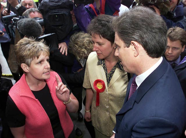 Tony Blair is confronted by Sharron Storer (PA Archive)