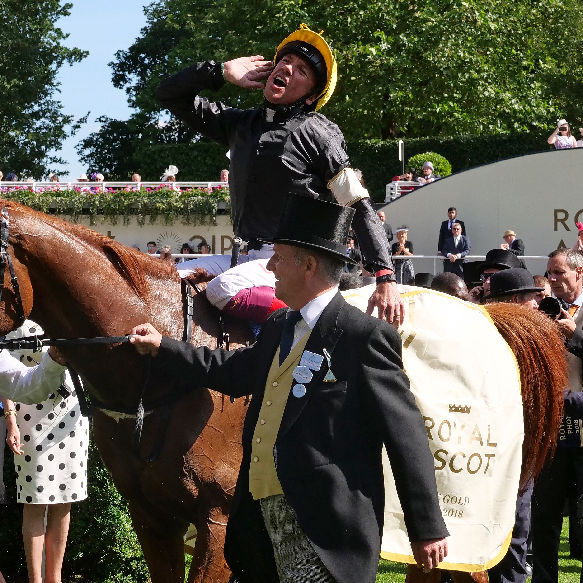 Jockey Frankie Dettori soaks up the applause as Stradivarius returns to the winner's enclosure following the Gold Cup at Royal Ascot