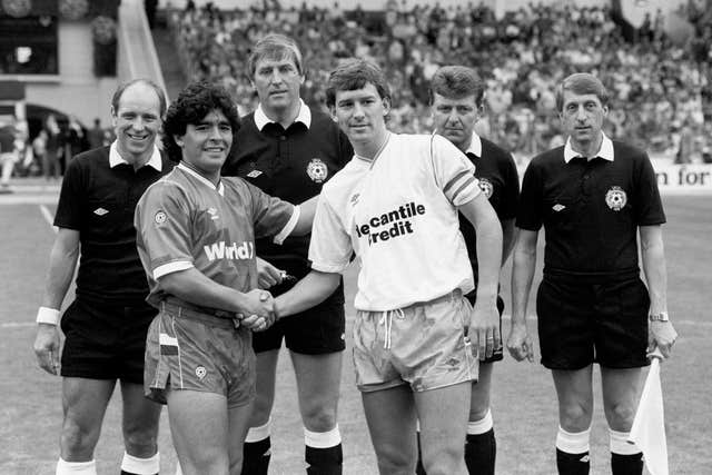 Maradona (left) captained a Rest of the World side against a Football League side captained by Brian Robson (right) in the Centenary Classic at Wembley