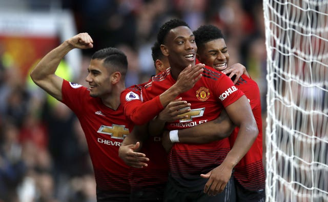 Manchester United's Anthony Martial (centre) celebrates scoring his side's second goal at Watford