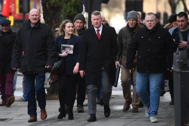 Britain First leader Paul Golding (centre) is flanked by supporters (Victoria Jones/PA)