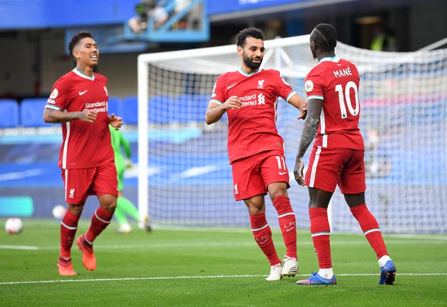 Liverpool forwards Roberto Firmino, Mohamed Salah and Sadio Mane celebrate a goal