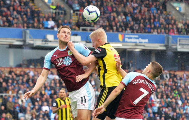 Burnley's Chris Wood and Watford's Will Hughes battle for the ball