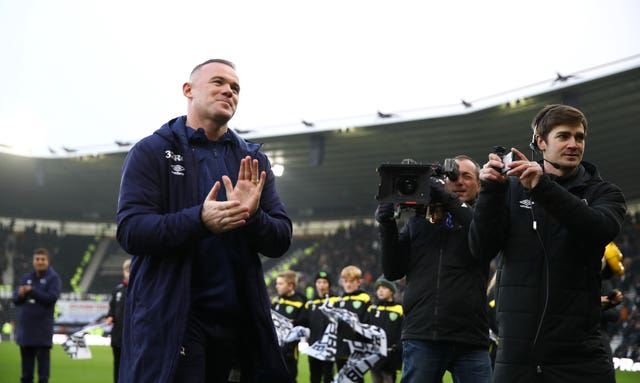Rooney is unveiled on the pitch before kick-off against QPR