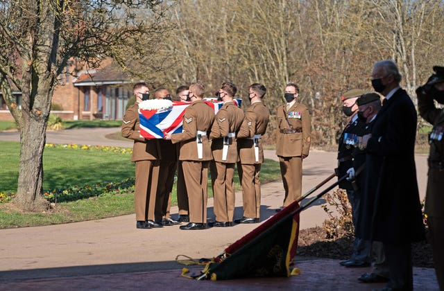 The coffin of Captain Sir Tom Moore was carried by members of the Armed Forces
