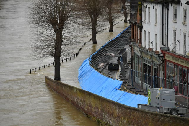 Temporary flood barriers hold back the river Severn in Ironbridge