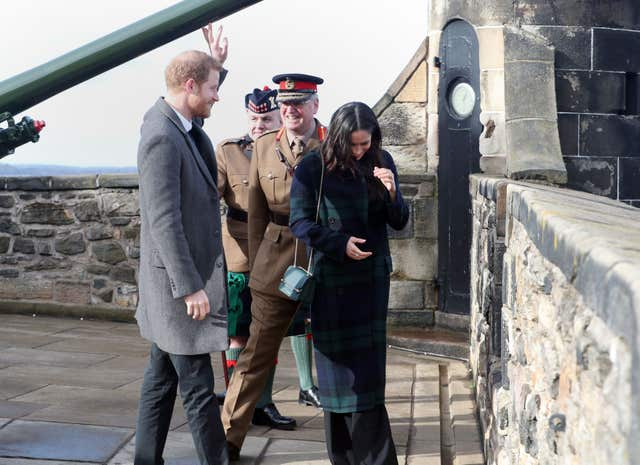 Prince Harry and Meghan Markle by the One o'clock gun at Edinburgh Castle (Jane Barlow/PA)