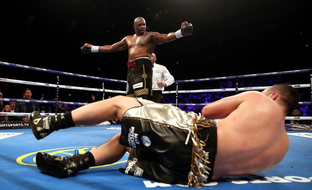Dillian Whyte (back) knocks down Joseph Parker