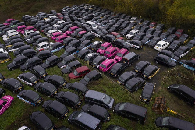 Hundreds of taxis are being stored in fields dotted around the edge of London due to the lack of customers (Victoria Jones/PA)