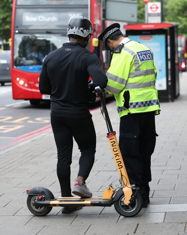 Metropolitan Police officers in Islington, north London issue a warning to an electric scooter rider (Yui Mok/PA)