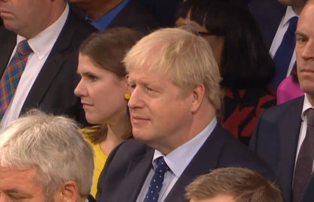 Boris Johnson listens to the speech