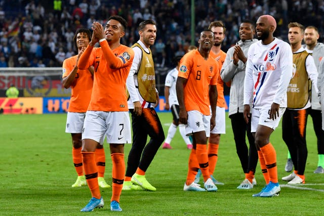 Dutch players celebrate their win over Germany