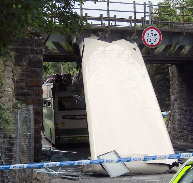 A double decker Lothian country bus that lost its roof after it hit a railway bridge in Shotts Road in Fauldhouse, West Lothian