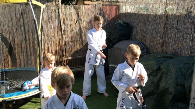 Undated handout photo issued by Gemma Clarke-Collins showing children doing virtual karate training during lockdown