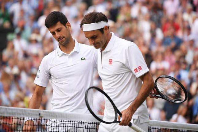 Djokovic , left, is congratulated by Roger Federer after the Wimbledon final