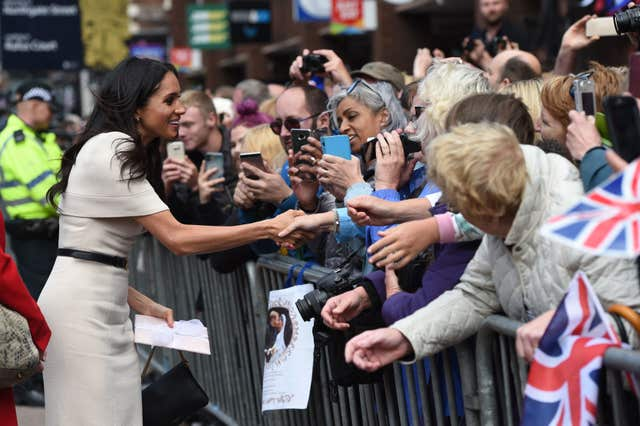 Meghan stopped to talk the crowds (Eddie Mulholland/Daily Telegraph/PA)