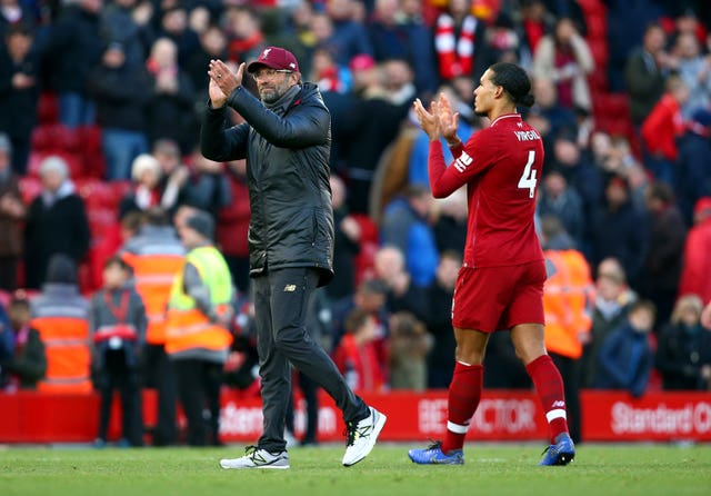 Jurgen Klopp, left, defended Virgil van Dijk after the Dutchman came in for criticism following his display in Belgrade (Dave Thompson/PA)