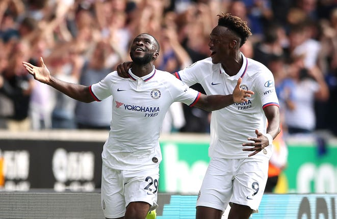 Fikayo Tomori, left, and Tammy Abraham celebrate Tomori's goal against Wolves