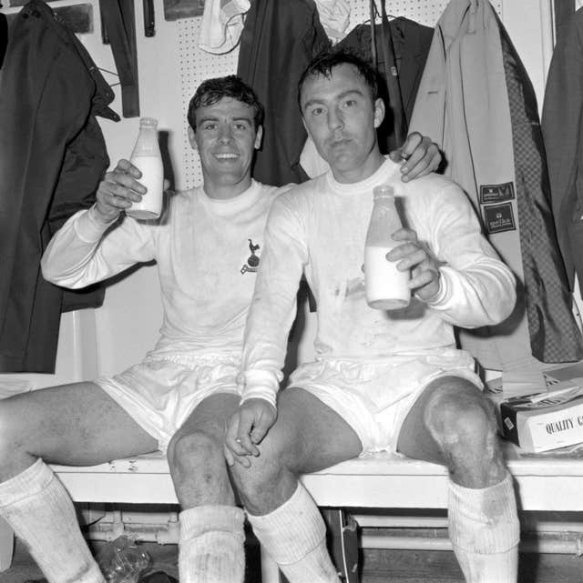 Jimmy Greaves, right, and Mike England celebrate winning the 1967 FA Cup with a pint of milk in the dressing room at Wembley