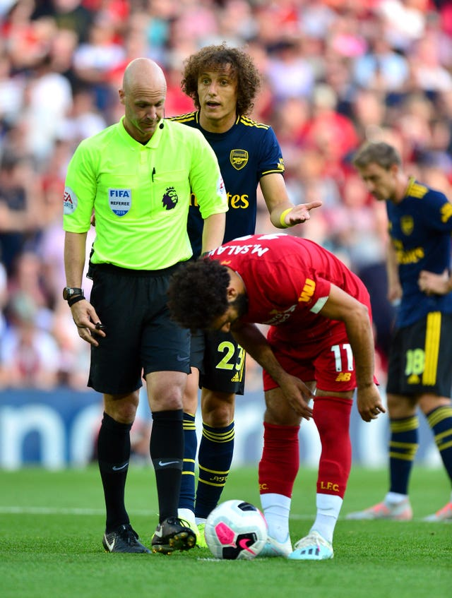 Mohamed Salah places the ball for his penalty as David Luiz, centre, protests to referee Anthony Taylor
