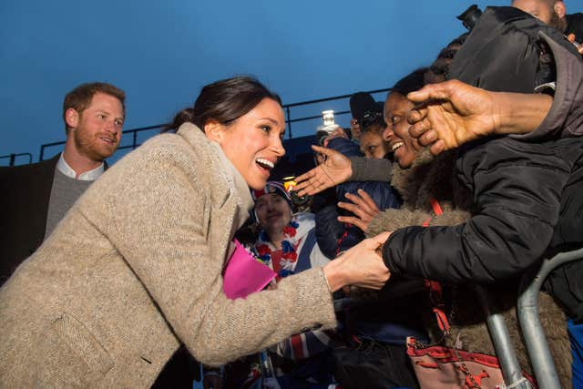 Harry and Meghan meet members of the public following a visit to youth-orientated radio station, Reprezent FM, in Brixton, south London last year. (Dominic Lipinski/PA)