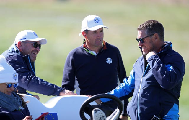 Padraig Harrington (centre) and fellow Team Europe vice-captain Lee Westwood (right) are in the running