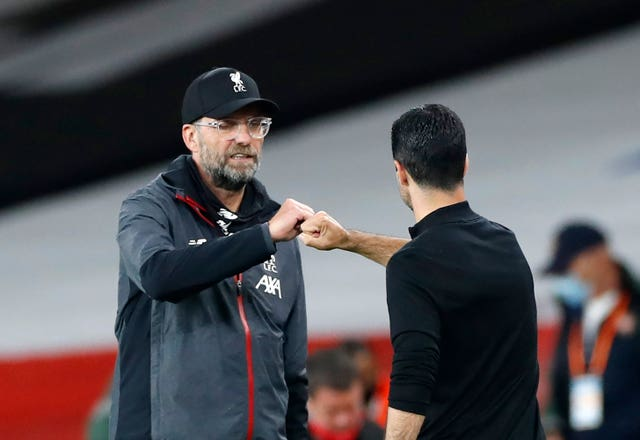 Liverpool manager Jurgen Klopp, left, is preparing to face Arsenal manager Mikel Arteta