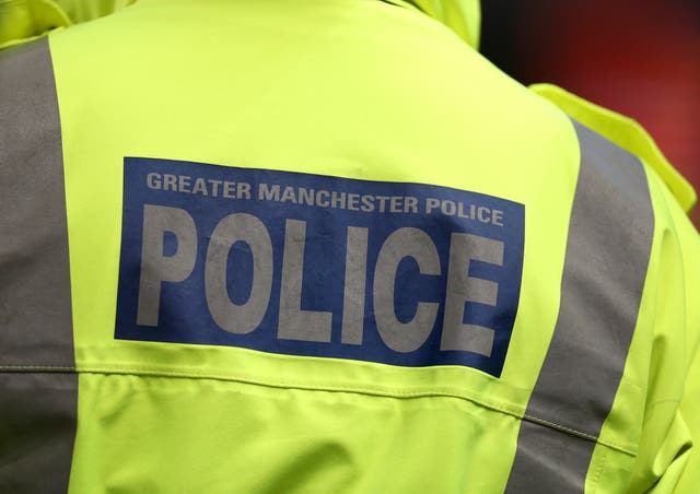 Greater Manchester Police took part in the raid (Peter Byrnbe/PA)