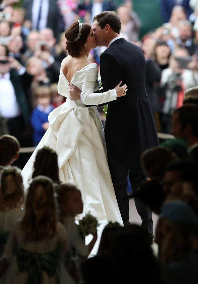Princess Eugenie and her new husband Jack Brooksbank kissing