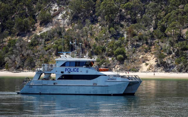 A police boat off Fraser Island, Queensland, ahead of the visit by the Duke of Sussex (Phil Noble/PA)