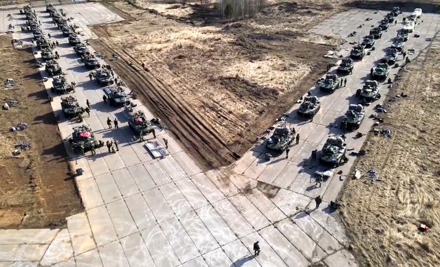 Russian military vehicles move during drills in Crimea
