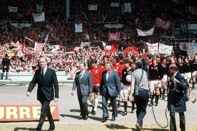 Tommy Docherty leads Manchester United out at Wembley for the 1977 FA Cup final