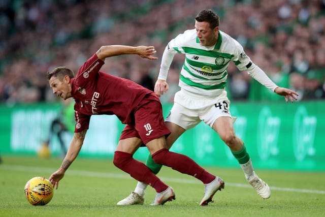 Makeshift left-back Callum McGregor (right) struggled out of position against Cluj