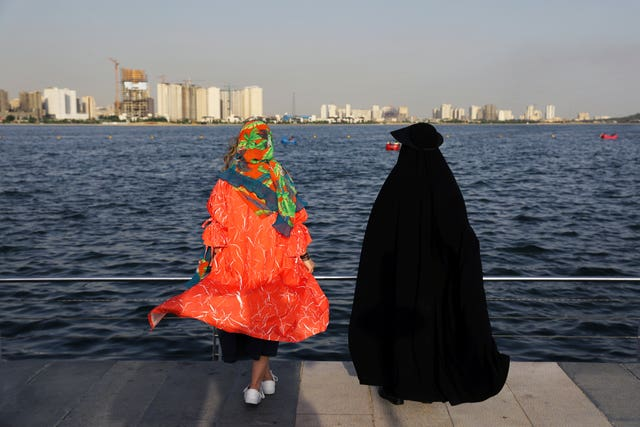 Women spend an afternoon around the Persian Gulf Martyrs' Lake in Tehran