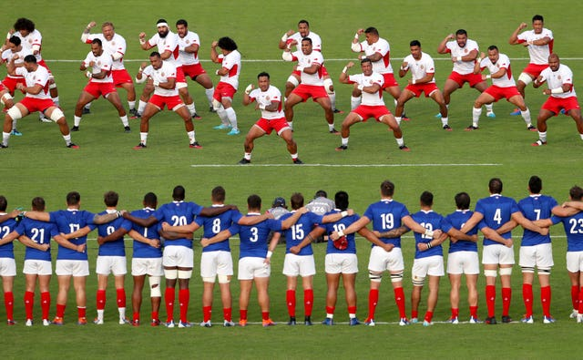 France look on as Tonga's players perform the Sipi Tau