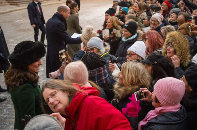 The Duke and Duchess of Cambridge meet members of the public during a walkabout in the streets of Stockholm during the first day of their Swedish tour (Dominic Lipinski/PA)