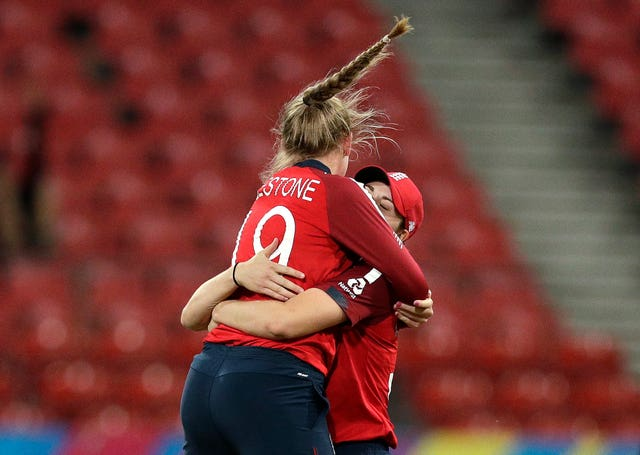 Sophie Ecclestone, left, became the youngest woman to reach 50 T20I wickets