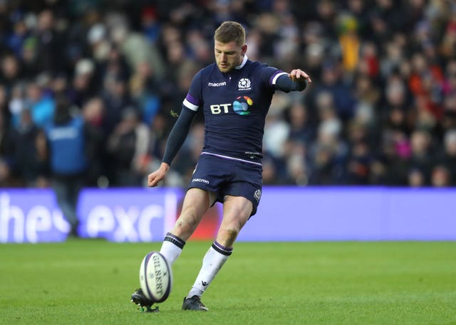 Scotland's Finn Russell kicks during the autumn international against Australia