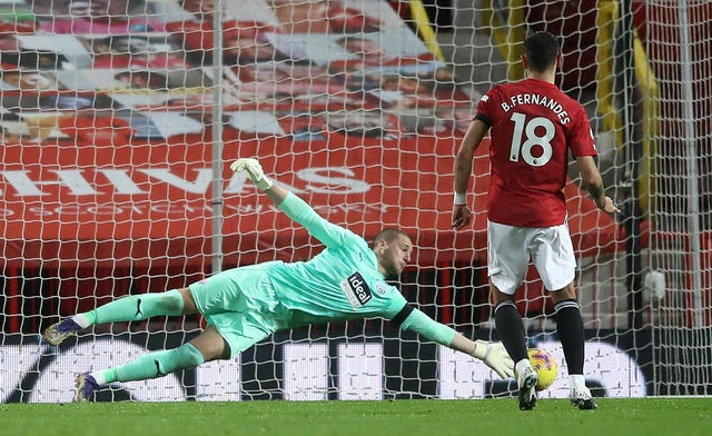 Sam Johnstone saved from Bruno Fernandes' penalty but had moved off his line too soon