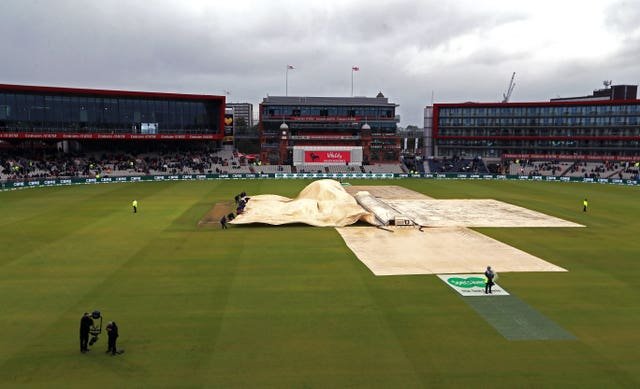 It was difficult to get the covers on on a blustery day at Old Trafford