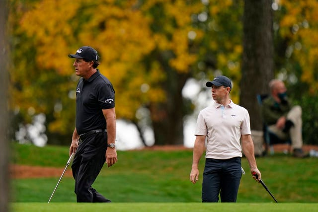 Phil Mickelson, left, has backed Rory McIlroy to win the Masters but it might not be this year