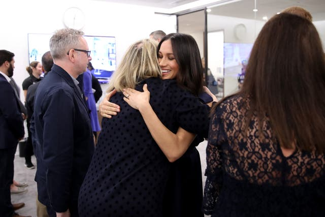 Meghan Markle hugs journalist Bryony Gordon as she meets panelists and beneficiaries during the first Royal Foundation Forum in central London (Chris Jackson/PA)