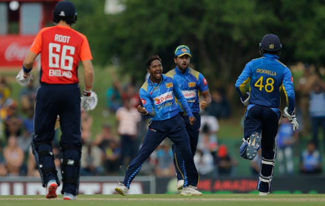 Sri Lanka's Akila Dananjaya, centre, celebrates the dismissal of Jason Roy (Eranga Jayawardena/AP).